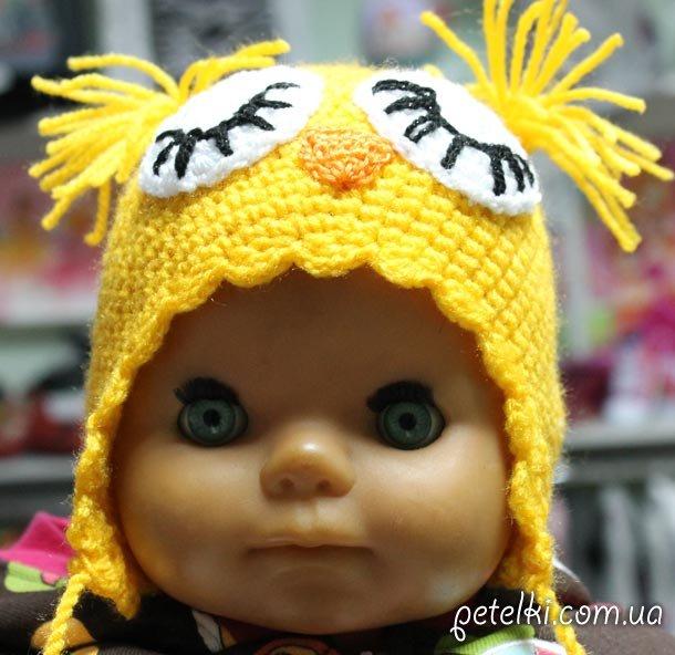 Детская вязаная шапочка Птичка